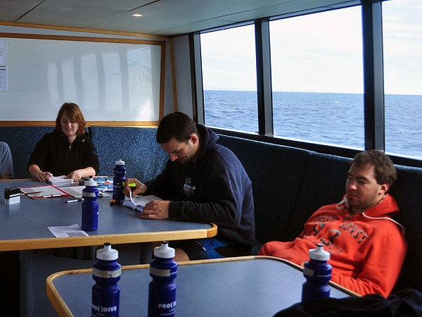 PADI Open Water students reviewing their notes