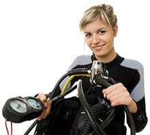 Female Scuba Diver Checking dive gauge